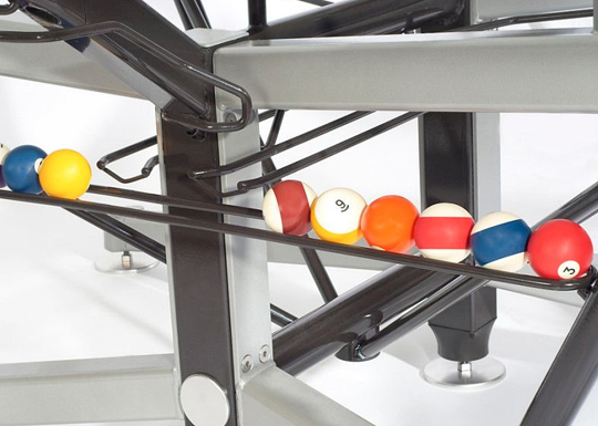 Glass top pool table ball return system
