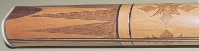 Hand carved pool cue inlay