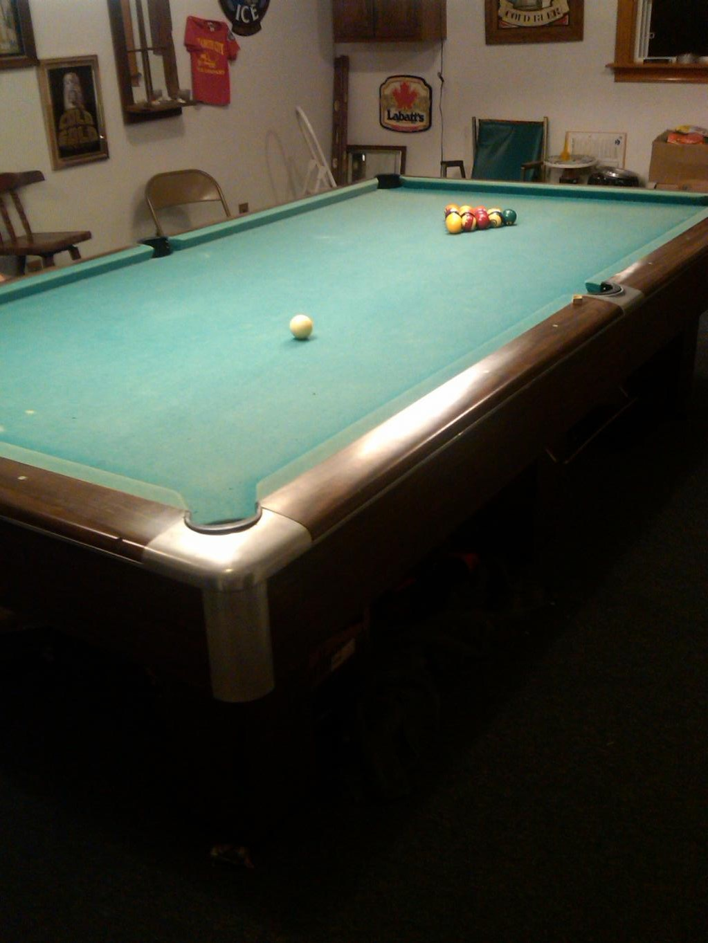 Luther Wimpy Lassiters personal 5 x 10 pool table, which apparently still has the old worsted wool cloth and billiard balls that Lassiter played with.