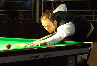 Photo of Mike Russell playing billiards #1
