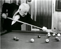 Photo of Willie Mosconi playing billiards #1