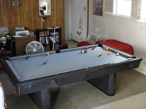 Billiard Table in Crowded Living Room