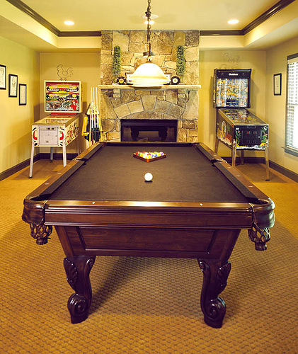 Home Gameroom With Pool Table and Pinball