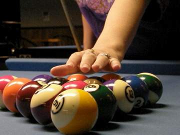Racking Pool Balls On Blue Pool Table Cloth