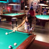 Woman Shooting Pool at Snooker's Billiards Providence