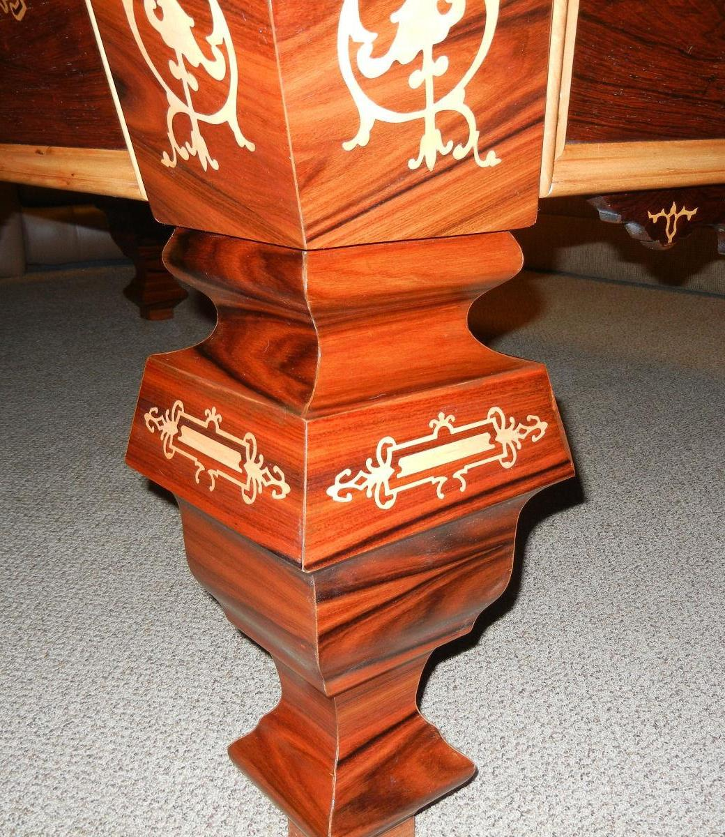 Example of a restored Brunswick pool table from the 1980s with intricate inlay work